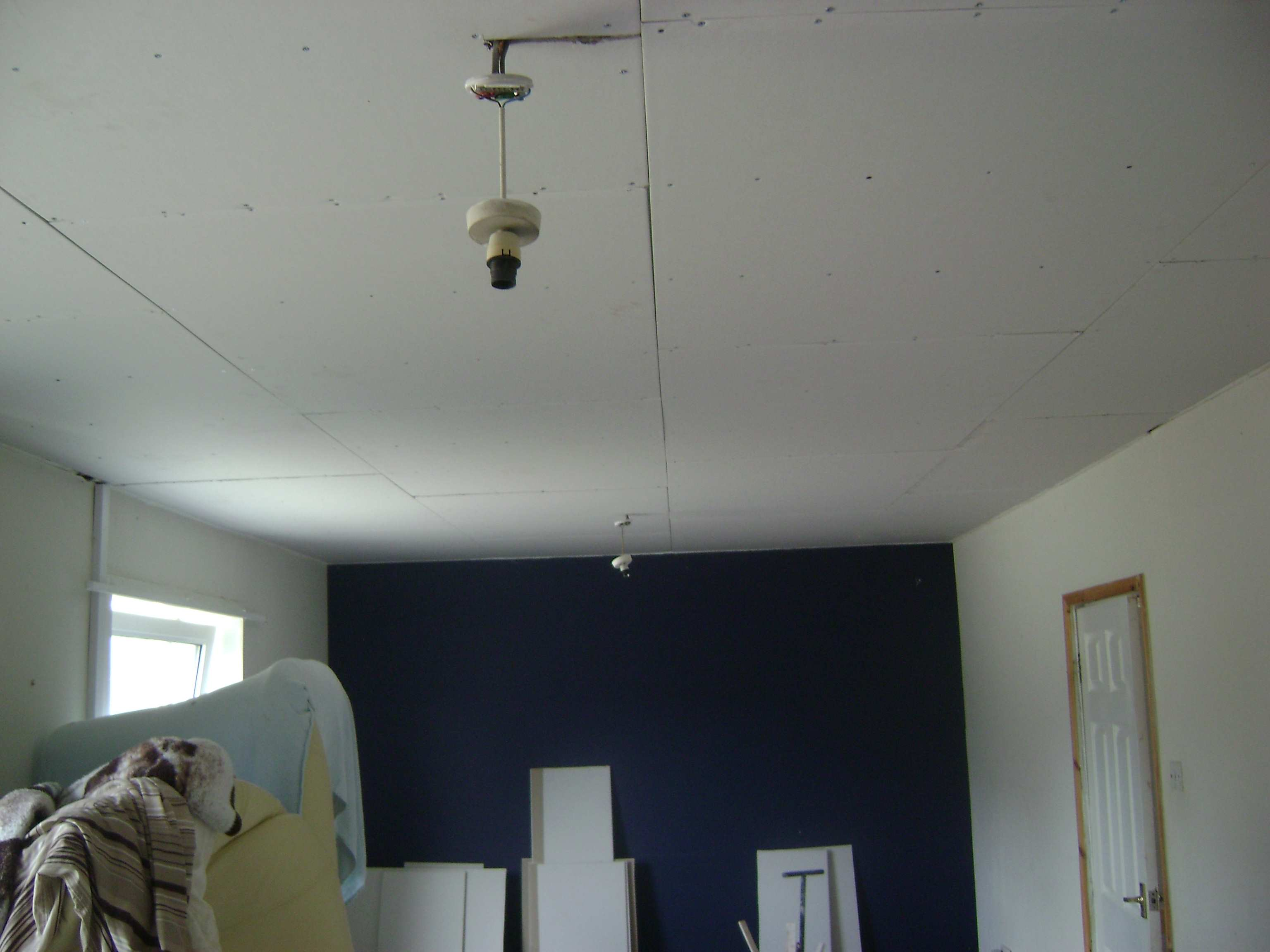Following removal of the timber battens, the joists were located and the ceiling was overboarded